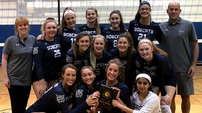 The Bel Air girls volleyball team celebrates its Class 3A North Region championship Friday night in Bel Air.