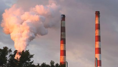 Emissions spew out of a large stack at the coal-fired Morgantown Generating Station two years ago in Newburg.