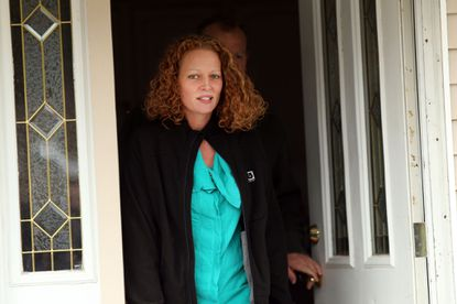 Kaci Hickox walks outside of her home to give a statement to the media on October 31, 2014 in Fort Kent, Maine. After returning from Sierra Leone where she worked with Doctors Without Borders treating Ebola patients, nurse Hickox publicly challenged a quarantine order by the state of Maine.