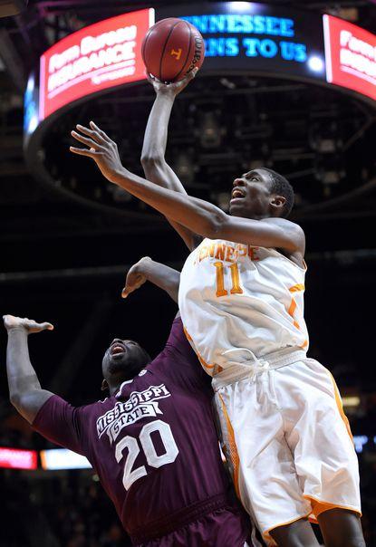 Tennessee forward Tariq Owens shoots over Mississippi State forward Gavin Ware.