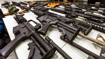 A variety of military-style semi-automatic rifles obtained during a buy-back program are displayed at Los Angeles police headquarters.