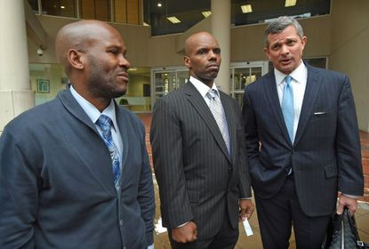Brent Matthews and Umar Burley, shown here in 2017 leaving the U.S. District Courthouse with their attorney Steve Silverman after a judge agreed to vacate their convictions because Baltimore police planted drugs on the men. Now they have settled their lawsuits against the city after spending time in prison.