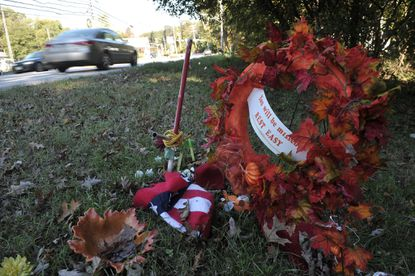 A wreath in autumn colors is placed next to a vacant house on Mountain Road. It is part of a memorial to Kala Marie Austin, 17, who was killed in a single car accident after loosing control of her car and striking the house on Mountain Road near Pinehurst Road.