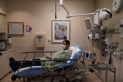 COVID-19 patient Daniel Wetherington waits for treatment in an emergency room at Mission Hospital in Mission Viejo, Calif., Monday, Dec. 21, 2020. (AP Photo/Jae C. Hong)