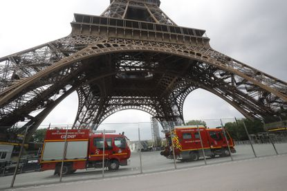 Rescue workers vehicles park just down the Eiffel Tower Monday, May 20, 2019 in Paris.