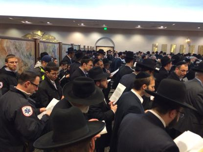 Hundreds pray and mourn four rabbis killed in Israel Tuesday at Shomrei Emunah in Baltimore.