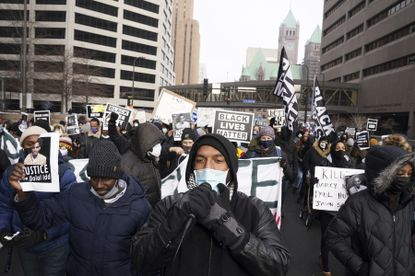 A group of Black Lives Matter protesters march through Minneapolis to demand justice for Jacob Blake, who was shot and paralyzed by police in Kenosha, Wisconsin, in January. (Anthony Souffle/Star Tribune via AP)