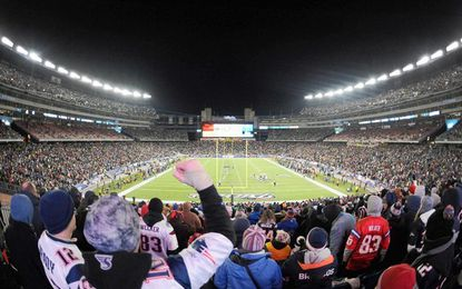 Patriots fans cheer during the AFC Divisional playoff game between the Denver Broncos and New England at Gillette Stadium. Die-hard Ravens fans have already begun plotting their trips to New England this weekend.