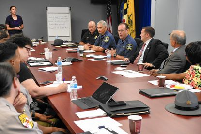 Harford COunty Sheriff Jeffrey Gahler, right center, group of police and community leaders gathered for a discussion of law enforcement and race in Bel Air Thursday morning.