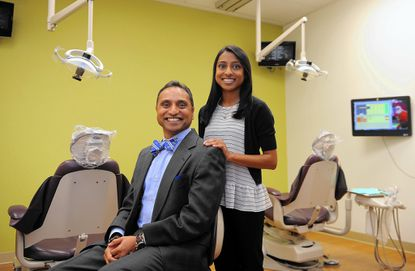 Dr. Deven Shroff, left, a pediatric dentist, and his daughter Anjali, right, 18, traveled to Guatemala for a 10 day mission with the Global Dental Relief organization. While there, they treated 800 patients. Anjali acted as the dental assistant.