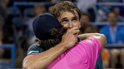 Alexander Zverev hugs his brother Mischa Zverev, foreground, after Alexander Zverev's 6-3, 7-5 win during the Citi Open tennis tournament in Washington, Thursday, Aug. 2, 2018. (AP Photo/Andrew Harnik)