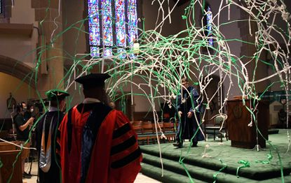 Confetti falls at the conclusion of the Loyola University of Maryland online graduation ceremony. The event was held in the Alumni Chapel on the campus. May 16, 2020