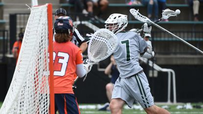 Loyola Maryland's Pat Spencer scores on Syracuse goalkeeper Drake Porter with a behind the back shot to take a 4-3 lead in the first period in the first round of the NCAA men's lacrosse tournament.