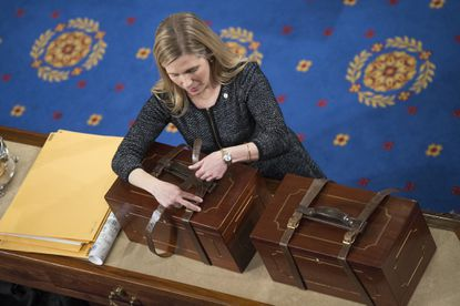 An aide opens Electoral College ballot boxes during a joint session of Congress to tally ballots for the president and vice president of the United States, January 06, 2017. (Photo By Tom Williams/CQ Roll Call)