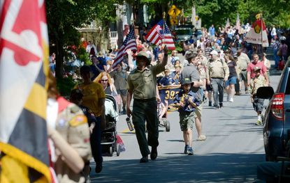 Scouting groups parade along East Main Street during the Westminster Memorial Day Parade Monday, May 27, 2019.