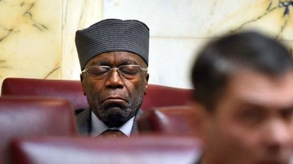 Former state Sen. Nathaniel Oaks sits in his seat in the rear of the Senate chamber on the first day of the 2018 legislative session at the State House.