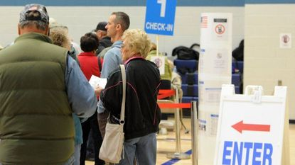Voters patiently wait inside the McFaul Center in Bel Air Thursday morning to cast their ballots on the first day of early voting in Harford County. Voter turnout was larger than anticipated by election officials.