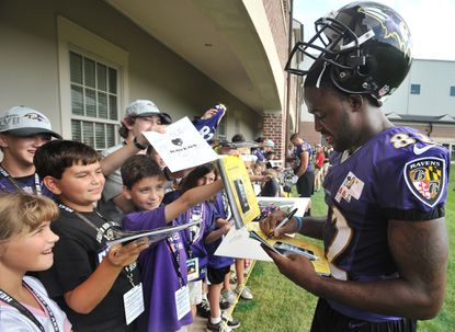 Torrey Smith, shown signing autographs for a line of kids after a full-squad workout in July, has become as revered in the city for his on-field production as his off-field outreach.