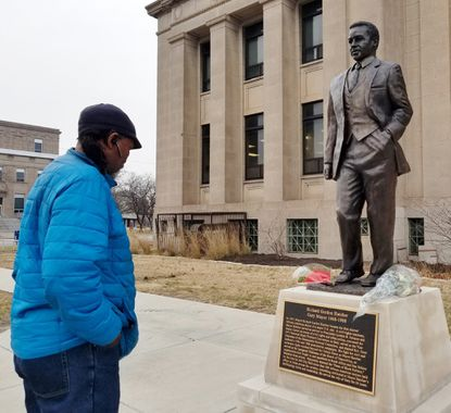 Gary native Darrell Head, of Chicago, pays his respects at the statue of Gary Mayor Richard Gordon Hatcher, who died Dec. 13 at age 86.