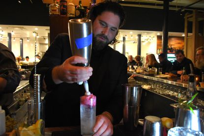 The brothers behind La Cuchara, Ben and Jake Lefenfeld, are opening Minnow at the 2 East Wells apartment building in South Baltimore. Jake Lefenfeld, pictured behind the bar at La Cuchara, will serve as the restaurant's general manager and oversee Minnow's bar program.