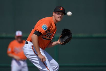 Orioles pitcher Kevin Gausman (39) participates in fielding drills during spring trainingat the Ed Smith Stadium complex on Feb. 20, 2016.