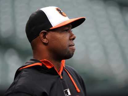 Alejandro De Aza waits for his turn for batting practice. Baltimore Orioles players work out the day before the Orioles home opener on April 9, 2015. De Aza was designated for assignment on May 27, 2015.