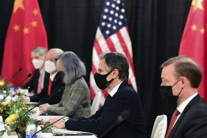 Secretary of State Antony Blinken, second from right, joined by national security adviser Jake Sullivan, right, listen as they meeti Chinese Communist Party foreign affairs chief Yang Jiechi and China's State Councilor Wang Yi at the opening session of US-China talks at the Captain Cook Hotel in Anchorage, Alaska, Thursday, March 18, 2021. (Frederic J. Brown/Pool via AP)