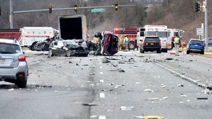 Vehicles and parts are strewn across all of the southbound lanes of Route 24 as police began accident reconstruction efforts after March 11 crash at the intersection of Route 24 and Ring Factory Road in Bel Air.