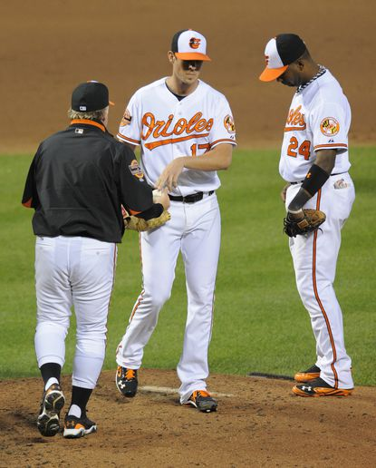 Orioles starting pitcher Brian Matusz, center, is removed from the game by manager Buck Showalter, left, in the sixth inning at Camden Yards as first baseman Wilson Betemit stands on the mound. Matusz allowed five runs and a career-high 13 hits in five-plus innings.