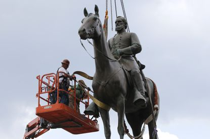 """Work crews remove the statue of Confederate general Stonewall Jackson, Wednesday, July 1, 2020, in Richmond, Va. In Maryland, some statues have come down as well but not what might be the state's most prominent tribute to the Confederacy, the state song, """"Maryland, My Maryland"""" that refers to Abraham Lincoln as a """"despot."""" AP Photo/Steve Helber)"""
