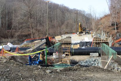 Contractors lay cement Jan. 23 on the foundation of what will be the new River Road Bridge after floodwaters in 2018 decimated the former structure. Its completion is expected spring 2020.