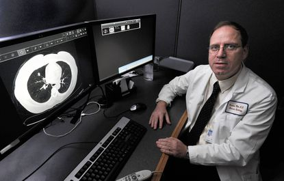 Dr. Charles White, thoracic cardiologist, in the Thoracic Reading Room at the University of Maryland Medical Center where he reads CT scans.