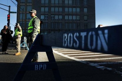 National Guard soldiers guard a roadblock near the Boston Marathon, where twin bombings near the marathon finish line last year resulted in the deaths of three people.
