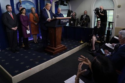 President Donald Trump takes questions during a press briefing with the coronavirus task force, in the Brady press briefing room at the White House, Tuesday, March 17, 2020, in Washington. (AP Photo/Evan Vucci)