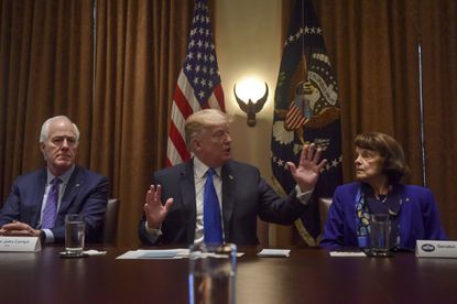 President Donald Trump, center, meets with members of Congress including Sens. John Cornyn, R-Texas, left, and Dianne Feinstein, D-Calif., on gun control at the White House on Feb. 28, 2018. Lawmakers have been kept off balance by Trump's leadership style.