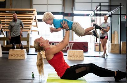 """Clara Paris, of Sykesville, finished in the top five in her group in a recent contest for the title of """"Ms. Health & Fitness."""" She is shown with her son, Tristan."""