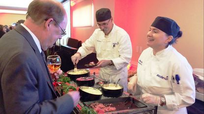 Chef Manager Kevin Casker and Executive Chef Shelley Funt, of Carroll Lutheran Village Dining Services, serve shaved beef tenderloin during the 2018 Taste of Carroll, which raised some $185,000 for Carroll Hospice. This year, Taste of Carroll is on April 29 with a $200,000 goal.