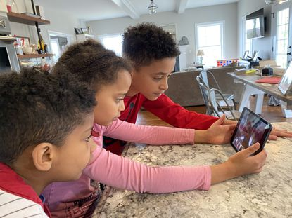 Three Connecticut kids — 7-year-old Matias, 8-year-old Sarai and 12-year-old Ezra Mendes — conduct a virtual play date with pals.