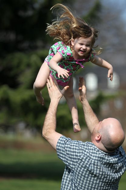 "Steve Sherman of Homeland catches his daughter Scarlett Sherman, 3, while playing outside at Sherwood Gardens. Sherwood Gardens will be sure to play a large part in the Guilford Centennial, despite losing longtime caretaker and volunteer Bruce Barnett to ""retirement."""