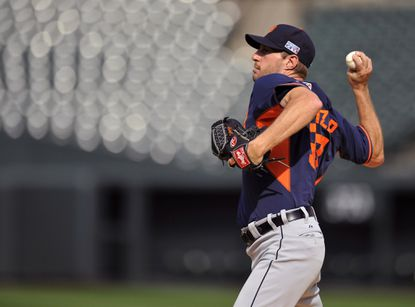 Tigers Game 1 starter Max Scherzer practices a pick off move to third base during workouts Wednesday at Camden Yards.