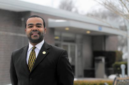Del. Charles Sydnor poses in front of the Wilkens Precinct in Catonsville. The District 44B delegate is the primary sponsor of a bill that would require the county and Baltimore City police departments to establish a pilot program that would help divert the mentally ill from the criminal justice system.