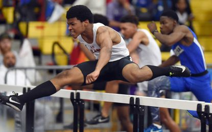 Dulaney's Abdul Henley clears a hurdle on his way to winning the 4A boys 55 meter hurdles during the MPSSAA Indoor Track State Championship Meet at Prince George's Sports Complex on Tuesday, Feb. 18.