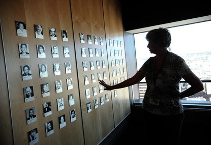 A woman stands by the 9/11 memorial exhibit on the top floor of the World Trade Center in this 2012 photo. The photographs are of Marylanders killed in the 9/11 attacks.