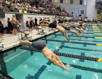 Start of the Men's 100 Freestyle at the Army-Navy Swim Meet at the Naval Academy Thursday evening.
