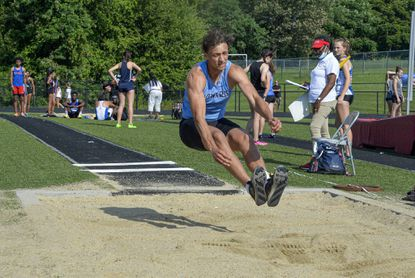 Howard High School Ibrahim Khairat competes in the long jump at the 2021 4A East Region track meet at North County High School.