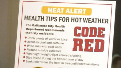 BALTIMORE, MD.--7/13/06--Dr. Joshua M. Sharfstein (cq), Baltimore City Health Commissioner, announced the city's plans for handling health risks for senior citizens during heat emergency in the summer months. The plans include a Code Red Heat Alert and the Baltimore City Energy Assistance initiative, which links residents with energy assistance programs. Lillian Jones, 78, left, who attends programs at the mid-town Waxter Senior Center, listen in on the press conference that announced the program. PHOTO BY KENNETH K. LAM/ BALTIMORE SUN DIGITAL IMAGE _DSC1211