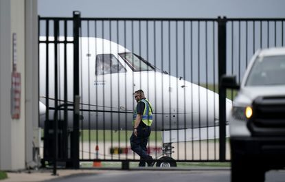 A private plane is readied for Democrats from the Texas Legislature as they arrive by bus to board and head to Washington, D.C., on July 12, 2021, in Austin, Texas. By leaving, Democrats again denied the GOP majority a quorum to pass bills, barely a month after their walkout thwarted the first push for sweeping new voting restrictions in Texas.