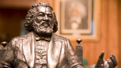 A sculpture of Frederick Douglass inside the Douglass Summer House Home of the Week in Highland Beach outside of Annapolis.