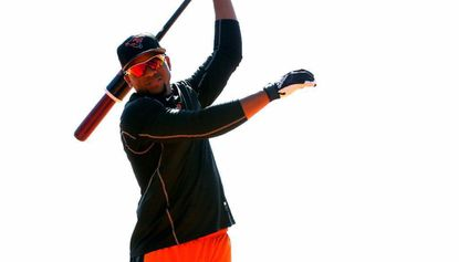 Yusniel Díaz takes practice swings before batting practice at spring training.