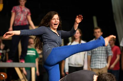 """Atholton High School freshman Maya Goldman, 14, does a spinning kick during rehearsal of """"The Wedding Singer"""" on Feb. 18. Maya plays the lead role of Holly in the musical."""